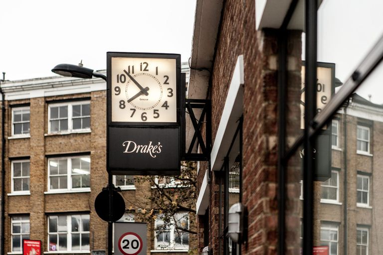 Drakes clock outside factory headquarter on Haberdasher street in London