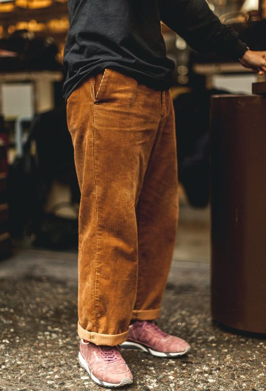 Wide brown corduroy pants with sneakers at Pitti Uomo 93