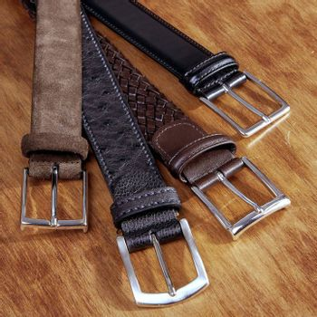 Guide Essential Belts. A picture of three woven leather belts from Andersons: one braided brown belt, one black plain leather belt and one suede belt. The fourth belt is a ostrich belt from Canali.