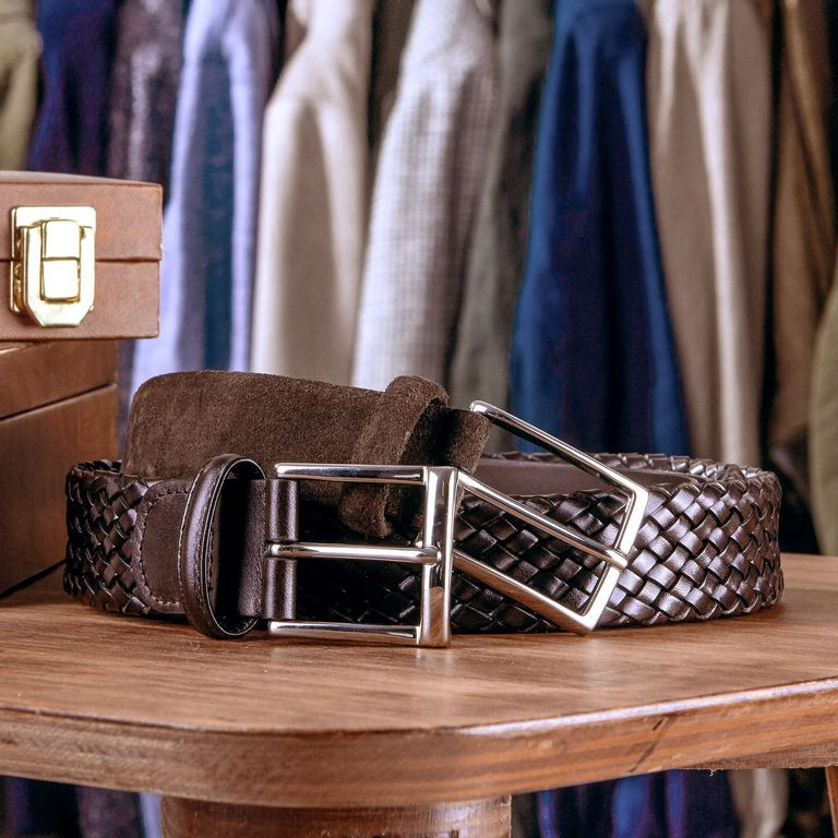Guide Essential Belts. A picture of a brown suede belt and a brown braided belt from Andersons