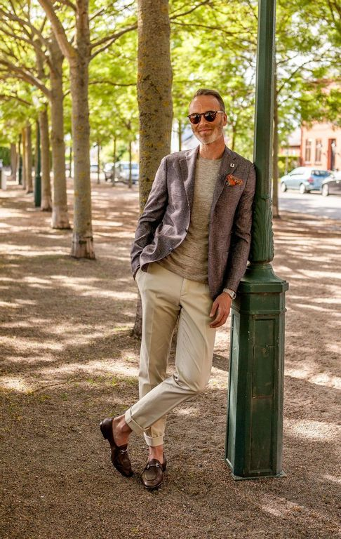 A picture of a swedish model standing in the park with clothes from Lardini, Gran Sasso and Ortigni and eyewear from the bespoke dudes