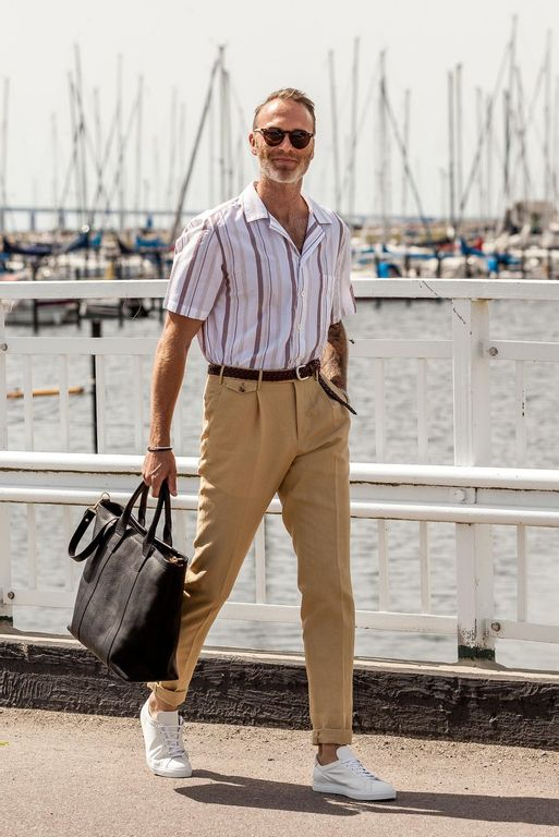 Dressed up man walking in the harbour in summer with clothes from Pantaloni Torino, Anderson's, Oscar Jacobson and Frank clegg.