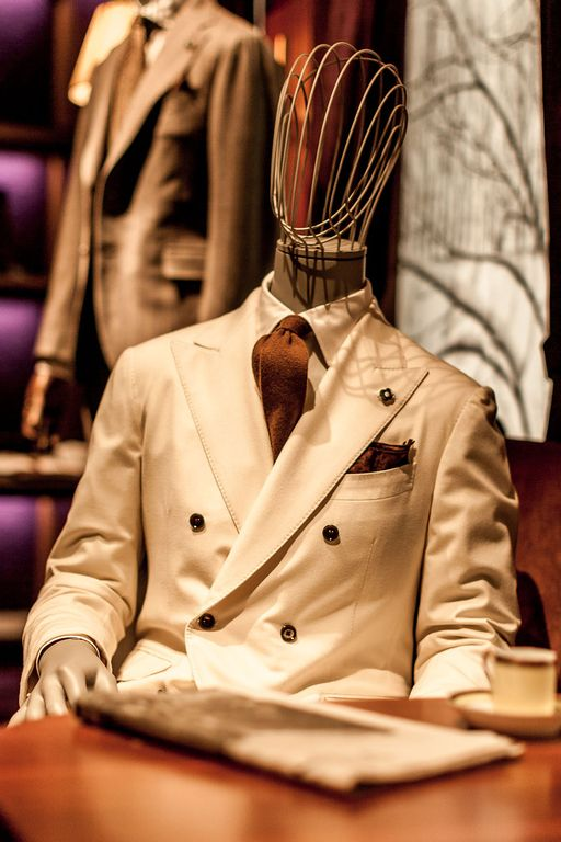 mannequin wearing a beige double breasted suit in lardini stand at pitti uomo 97