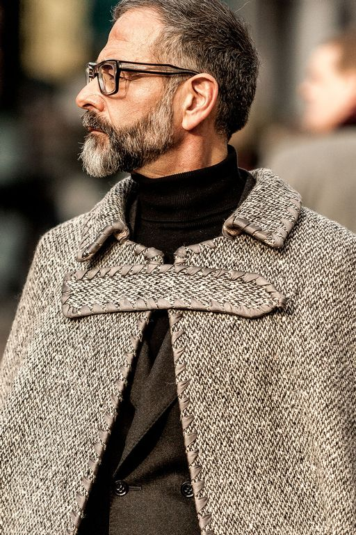 bearded man with glasses wearing a grey mantel coat at pitti uomo 97