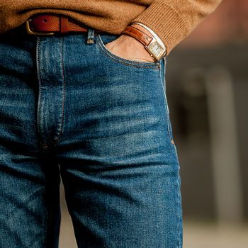 model standing with hand in denim jeans pocket